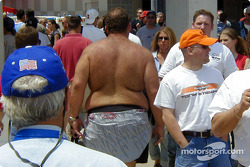 Shirtless fat guy with back hair who just doesn't care