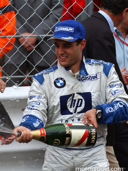 Champagne for race winner Juan Pablo Montoya