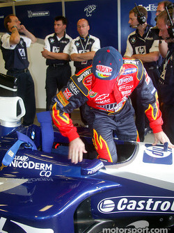 Jeff Gordon climbs into the cockpit of the FW24