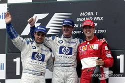 The podium: race winner Ralf Schumacher with Juan Pablo Montoya and Michael Schumacher