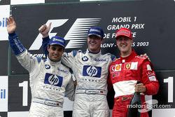 The podium: race winner Ralf Schumacher with Juan Pablo Montoya and Michael Schumacher