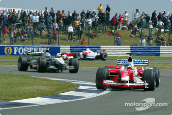 Cristiano da Matta leads David Coulthard