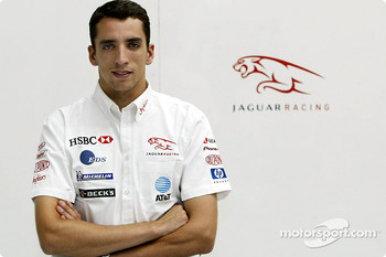 Justin Wilson poses after his transfer to Jaguar Racing from Minardi at the Jaguar Racing factory in Milton Keynes
