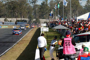 Ford fans cheer after Marcos Ambrose takes second with Mark Skaife retiring with a blown engine 7 laps from the end