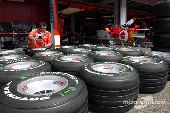 Ferrari team member prepares tires