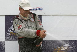 The podium: champagne for race winner Scott Pruett