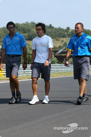 Fernando Alonso walks around the track