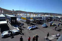 American Le Mans Series cars are pushed through the paddock area at Mazda Raceway Laguna Seca Saturday prior to the start of qualifying