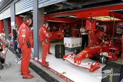Ross Brawn watches Michael Schumacher