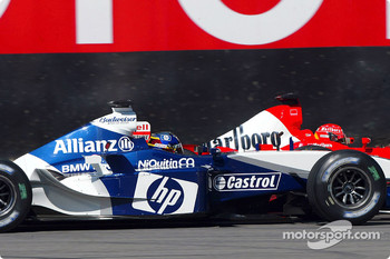 Michael Schumacher battles with Juan Pablo Montoya
