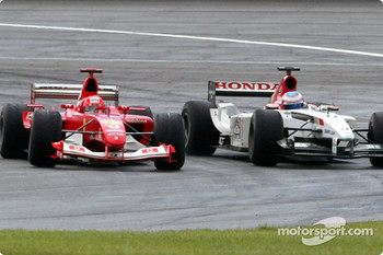 Michael Schumacher passes Jenson Button