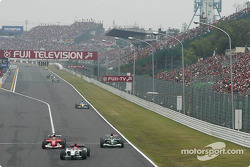 Michael Schumacher passes Mark Webber behind Takuma Sato