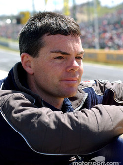 A relaxed Craig Lowndes monitors team mate Glenn Seton