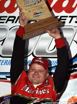 Race winner Bobby Hamilton Jr. celebrates