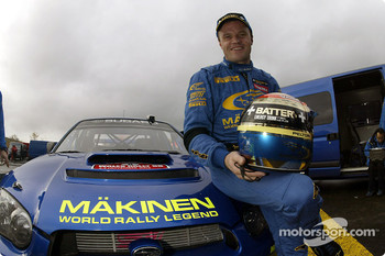 Tommi Makinen celebrates his last WRC event with Subaru
