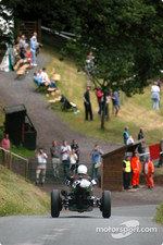 Mac Hulbert returns down the famous Shelsley Walsh hill after having just broken the pre war car record, lowering it to 34.05 seconds