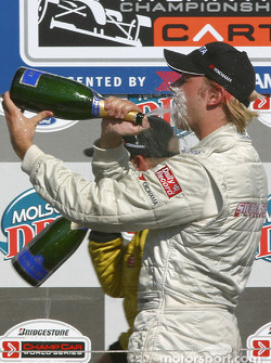 Podium: champagne for Ryan Dalziel