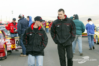 Richard Steranka (l) of Rennwerks and Johannes van Overbeek (r) of Flying Lizard Motorsports walk down the starting grid