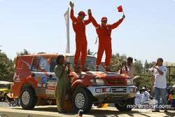 Luo Ding and Serge Henninot celebrate on the finish podium
