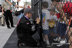 Race winner J.J. Yeley takes care of his fans