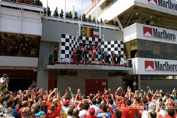 Podium: race winner Michael Schumacher with Rubens Barrichello and Jarno Trulli