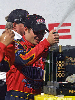 Victory circle: champagne for race winner Jeff Gordon