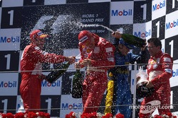 Podium: champagne for Michael Schumacher, Fernando Alonso and Rubens Barrichello
