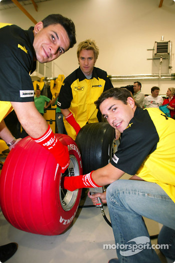 Timo Glock, Giorgio Pantano and Nick Heidfeld change a red Bridgestone tyre and wear a red sock in aid of Sport relief