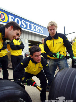 Jordan drivers Timo Glock, Nick Heidfeld and Giorgio Pantano compete against the engineers in a pitstop challenge