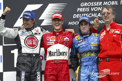 Podium: race winner Michael Schumacher with Jenson Button, Fernando Alonso and Paolo Martinelli