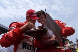 Michael Schumacher and Chris Dyer on the starting grid