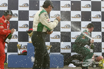 Podium: champagne shower for  Tomy Drissi, Tommy Kendall and Garrett Kletjian, while Paul Gentilozzi is on the ground