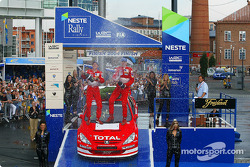 Podium: champagne for Marcus Gronholm and Timo Rautiainen