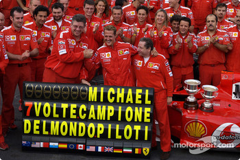 Michael Schumacher celebrates 7th World Championship with Ferrari team members