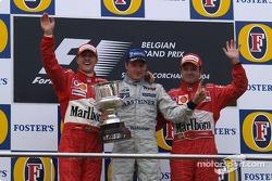 Podium: race winner Kimi Raikkonen with Michael Schumacher and Rubens Barrichello