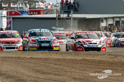 Mark Skaife and the rest of the field head into turn 1