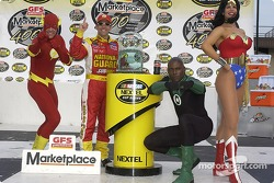 Victory lane: race winner Greg Biffle celebrates with The Flash, Green Lantern and Wonder Woman