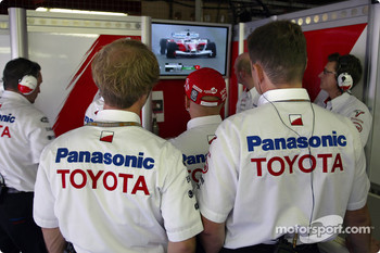 Toyota team members watch Olivier Panis qualifies