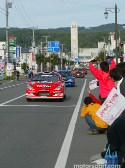 Japanese fans wave at competitors