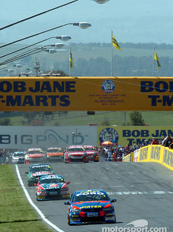 Marcos Ambrose, team mate Russell Ingall and John Bowe lead after the first lap
