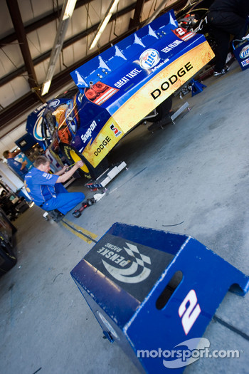 The No. 2 Miller Lite crew works on the car