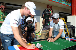 Nico Rosberg, Mercedes GP and Michael Schumacher, Mercedes GP play table football