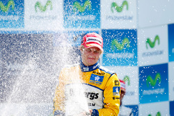 Marcus Ericsson celebrates his victory on the podium