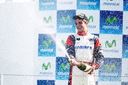 Nico Muller celebrates on the podium