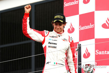 Esteban Gutierrez celebrates victory on the podium