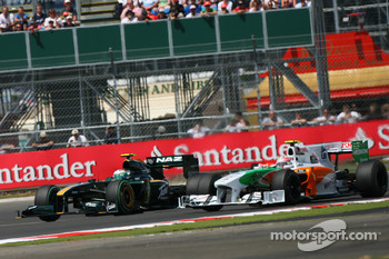 Heikki Kovalainen, Lotus F1 Team and Vitantonio Liuzzi, Force India F1 Team