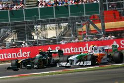 Heikki Kovalainen, Lotus F1 Team and Vitantonio Liuzzi, Force India F1 Team