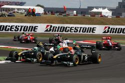 Heikki Kovalainen, Lotus F1 Team, Jarno Trulli, Lotus F1 Team