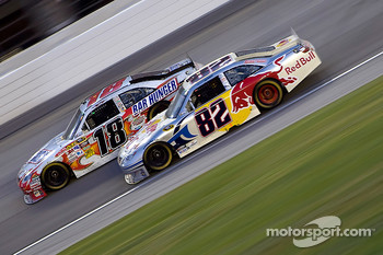 Kyle Busch, Joe Gibbs Racing Toyota and Scott Speed, Red Bull Racing Team Toyota