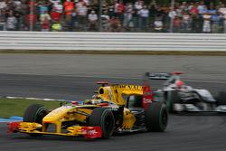 Robert Kubica, Renault F1 Team leads Michael Schumacher, Mercedes GP